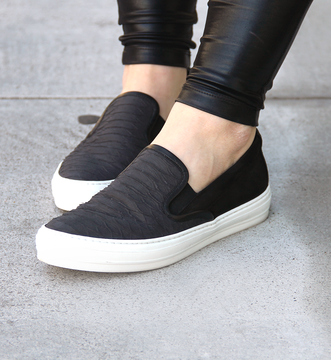 A casual alternative to loafers, slip-on sneakers are a versatile addition to any shoe collection. Look to luxe finishes and added embellishments for high fashion appeal, or classic canvas construction and fun prints for a more laidback approach.