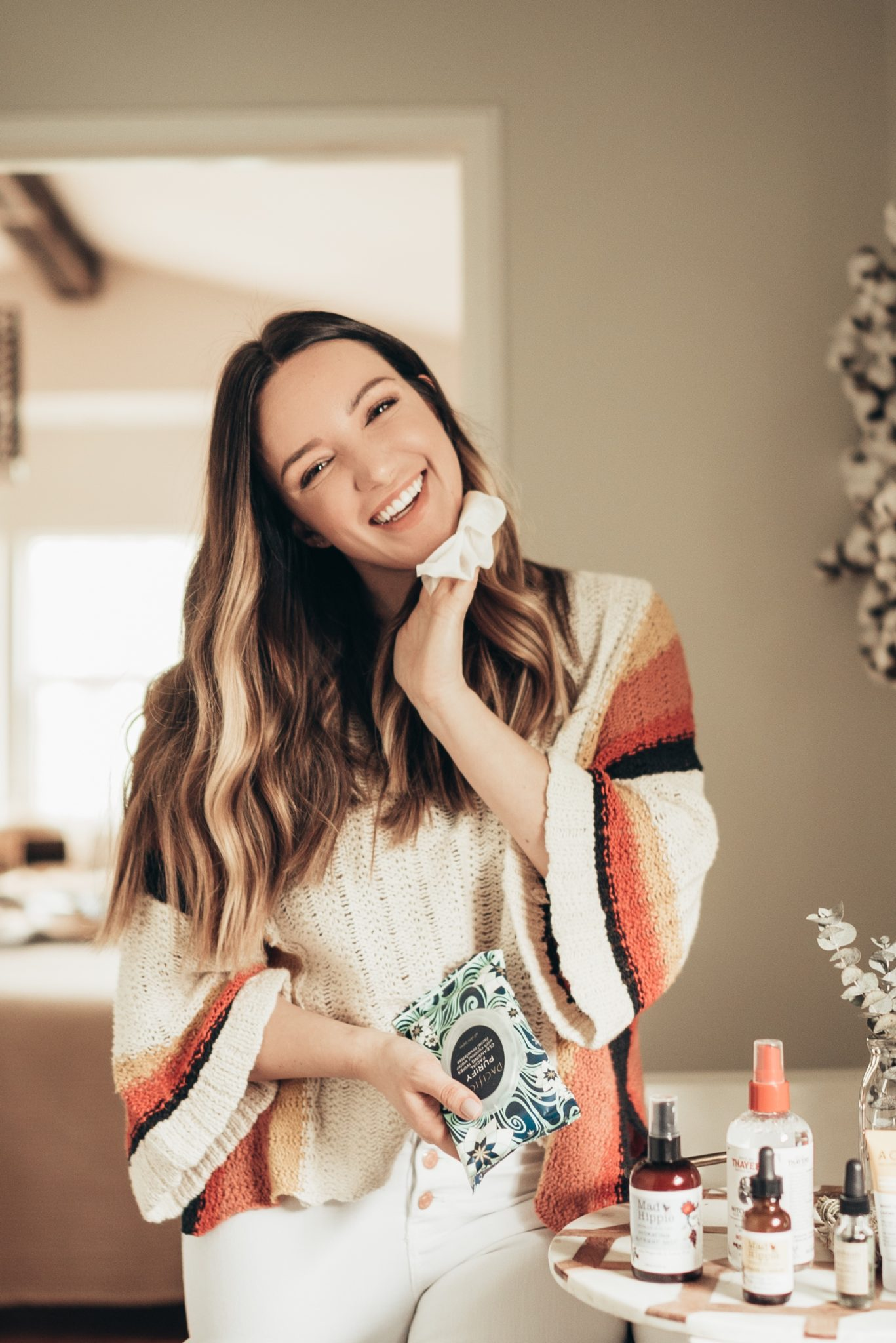 Best Natural Beauty Products featured by top US beauty blog Just Add Glam; Image of a woman wearing a striped cardigan.
