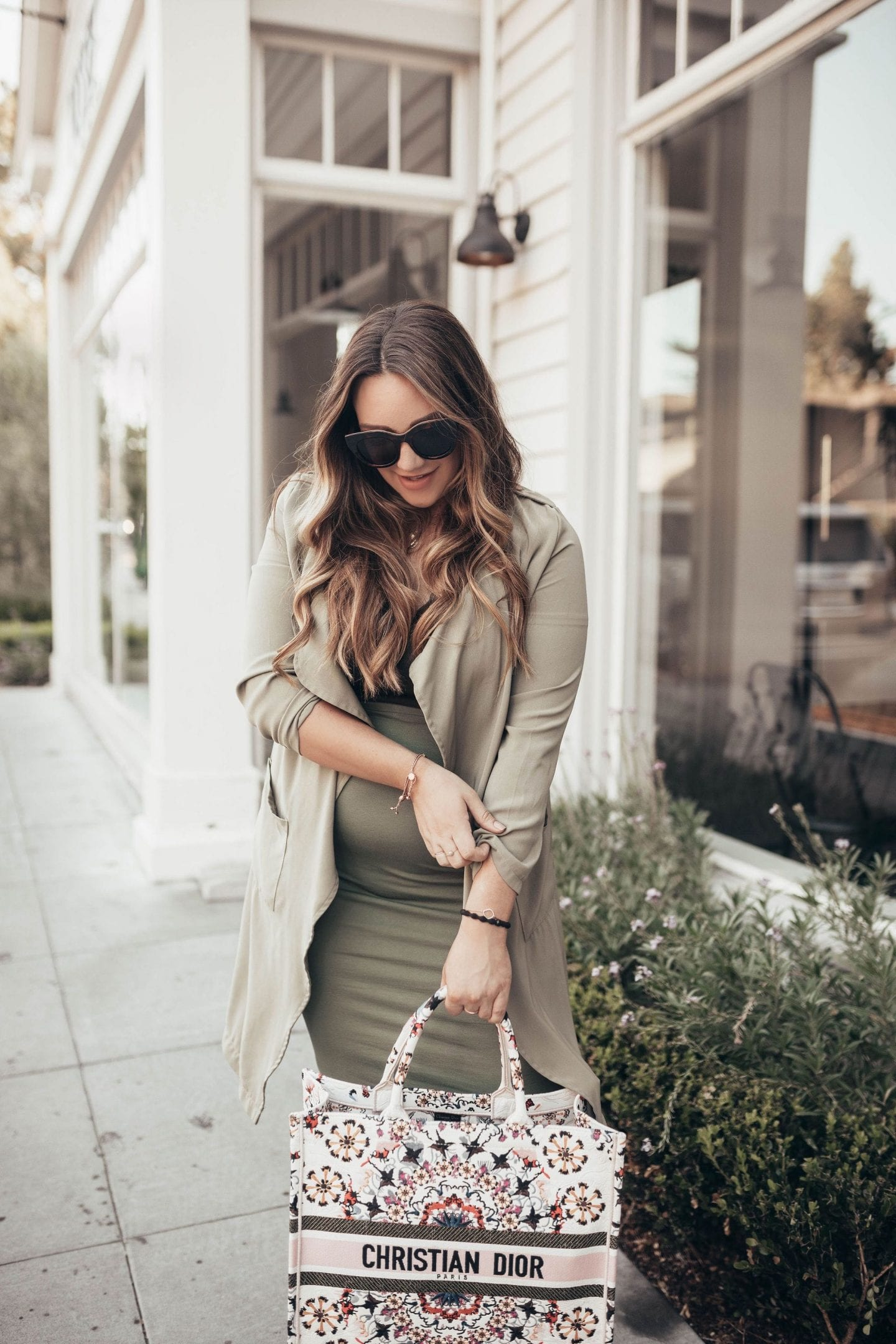 5 Cool Mom Outfits For Fall From Target I Fall Fashion I Back To School Fashion I Fashion Blog I via justaddglam.com   5 Cool Mom Fall Outfits From Target by popular San Francisco fashion blog, Just Add Glam: image of a woman wearing a olive green pencil skirt, black top, trench coat, and carrying a Christian Dior bag.