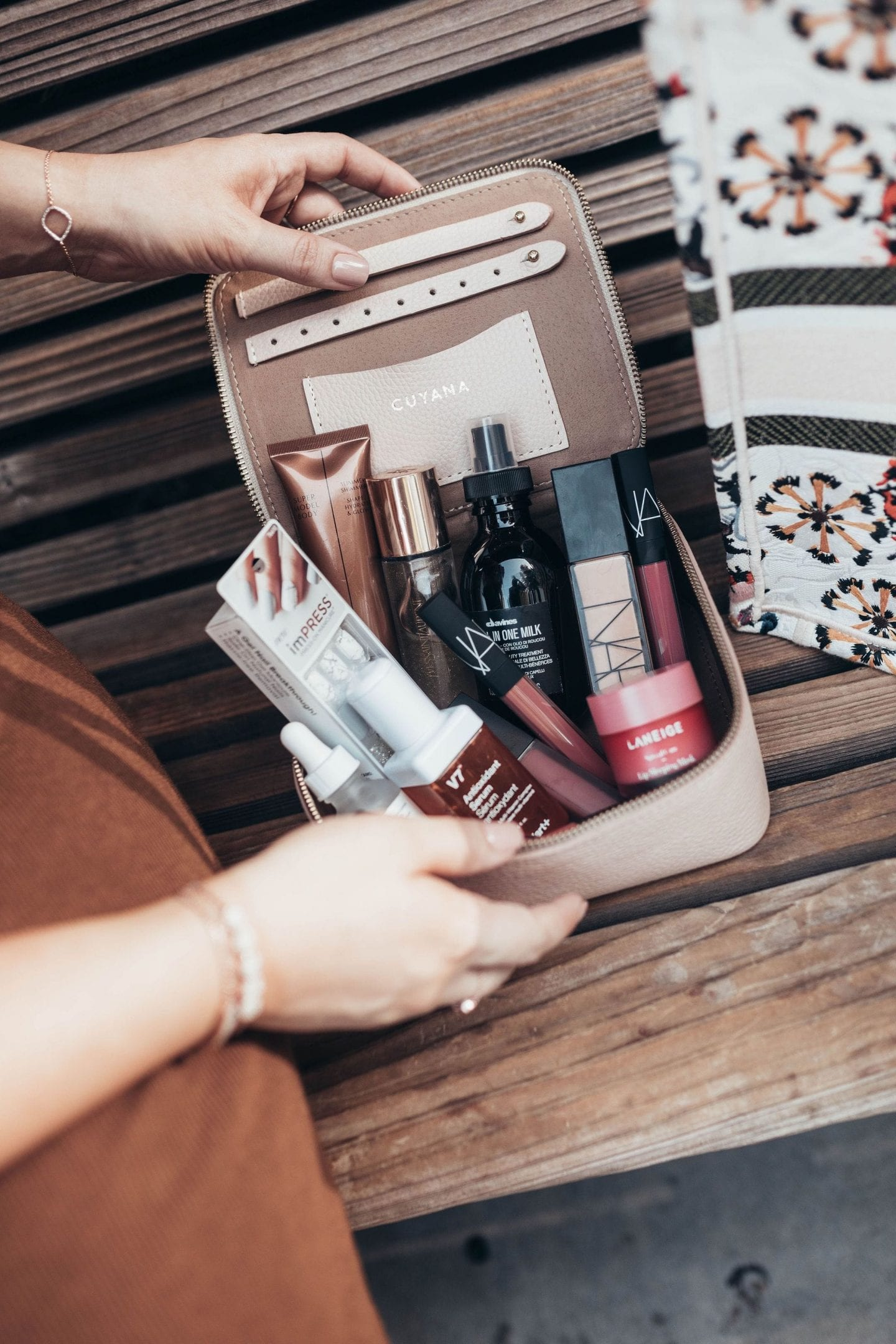 The Ultimate Walmart Fall Beauty Roundup I beauty blog I Walmart beauty I via justaddglam.com | The Ultimate Walmart Fall Beauty Products Roundup by popular San Francisco beauty blog, Just Add Glam: image of a woman opening her makeup bag.