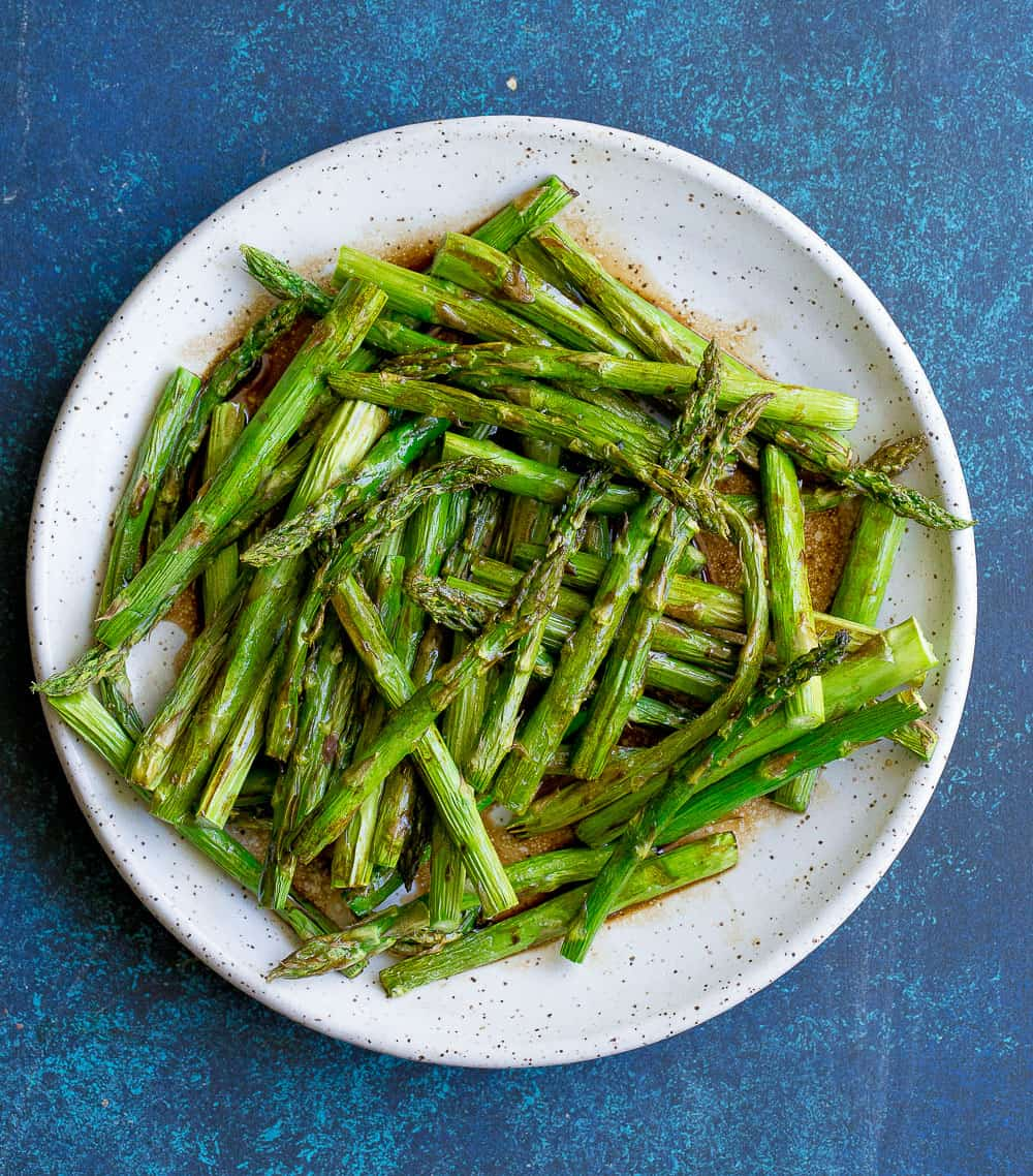 Keto Thanksgiving Recipes featured by top US lifestyle blog, Just Add Glam: air fryer asparagus