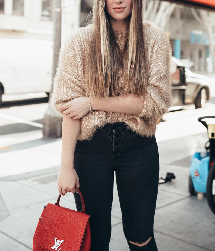 BEST DENIM BLACK FRIDAY DEALS FOR 2019 by popular San Francisco life and style blog Just Add Glam: image of a woman outside wearing a pair of black denim jeans.