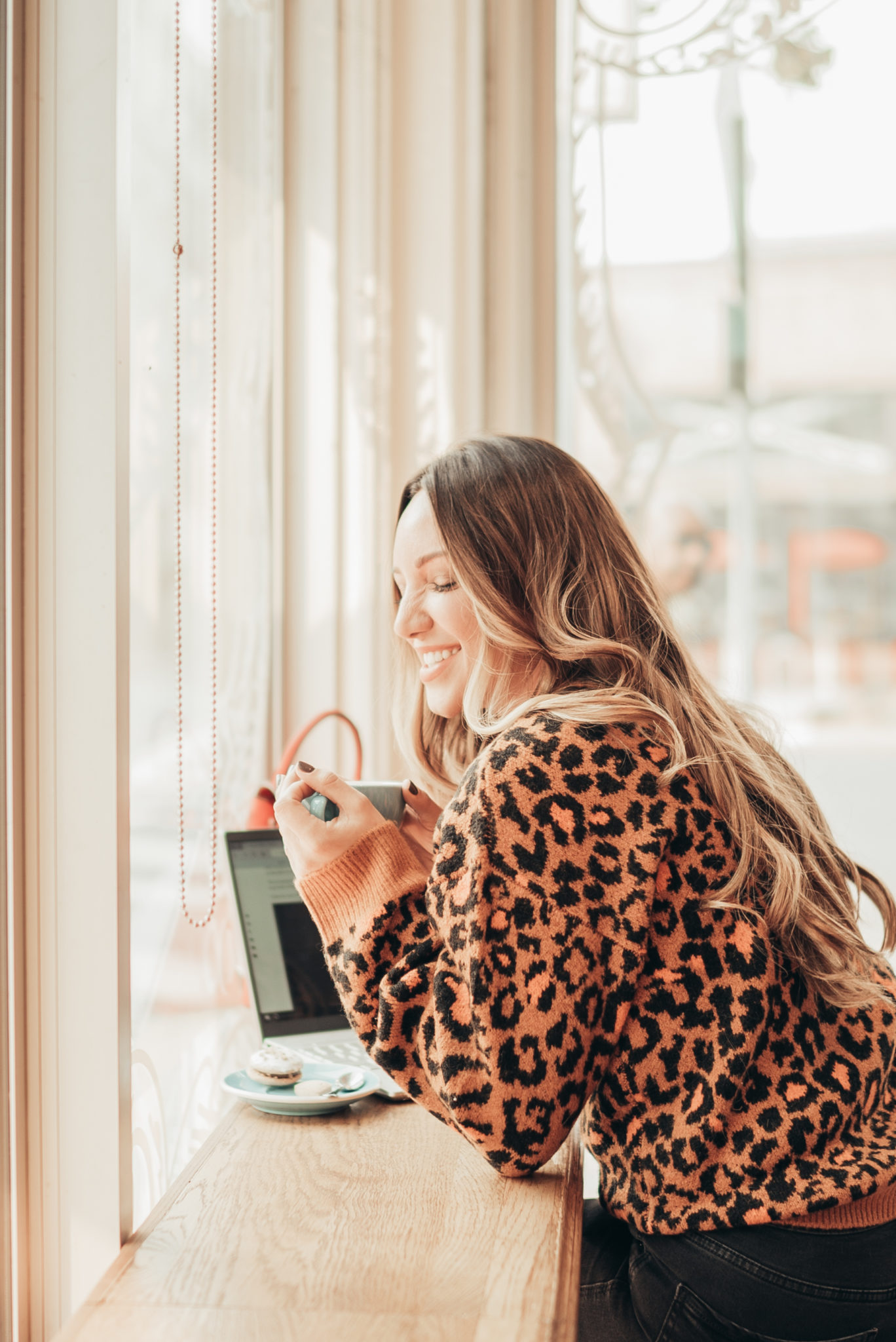 BLACK FRIDAY & CYBER MONDAY DEALS AND DISCOUNT CODES 2019 by popular San Francisco life and style blog, Just Add Glam: image of a woman sitting at a counter in a coffee shop.