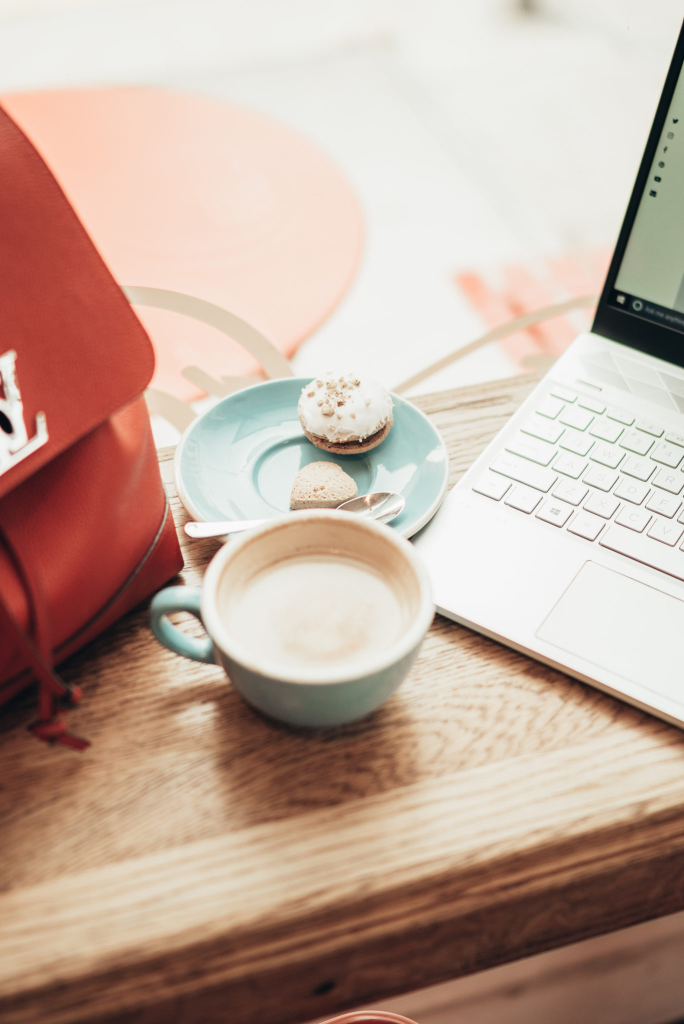 BLACK FRIDAY & CYBER MONDAY DEALS AND DISCOUNT CODES 2019 by popular San Francisco life and style blog, Just Add Glam: image of a cappuccino, a plate of cookies, and an open laptop.