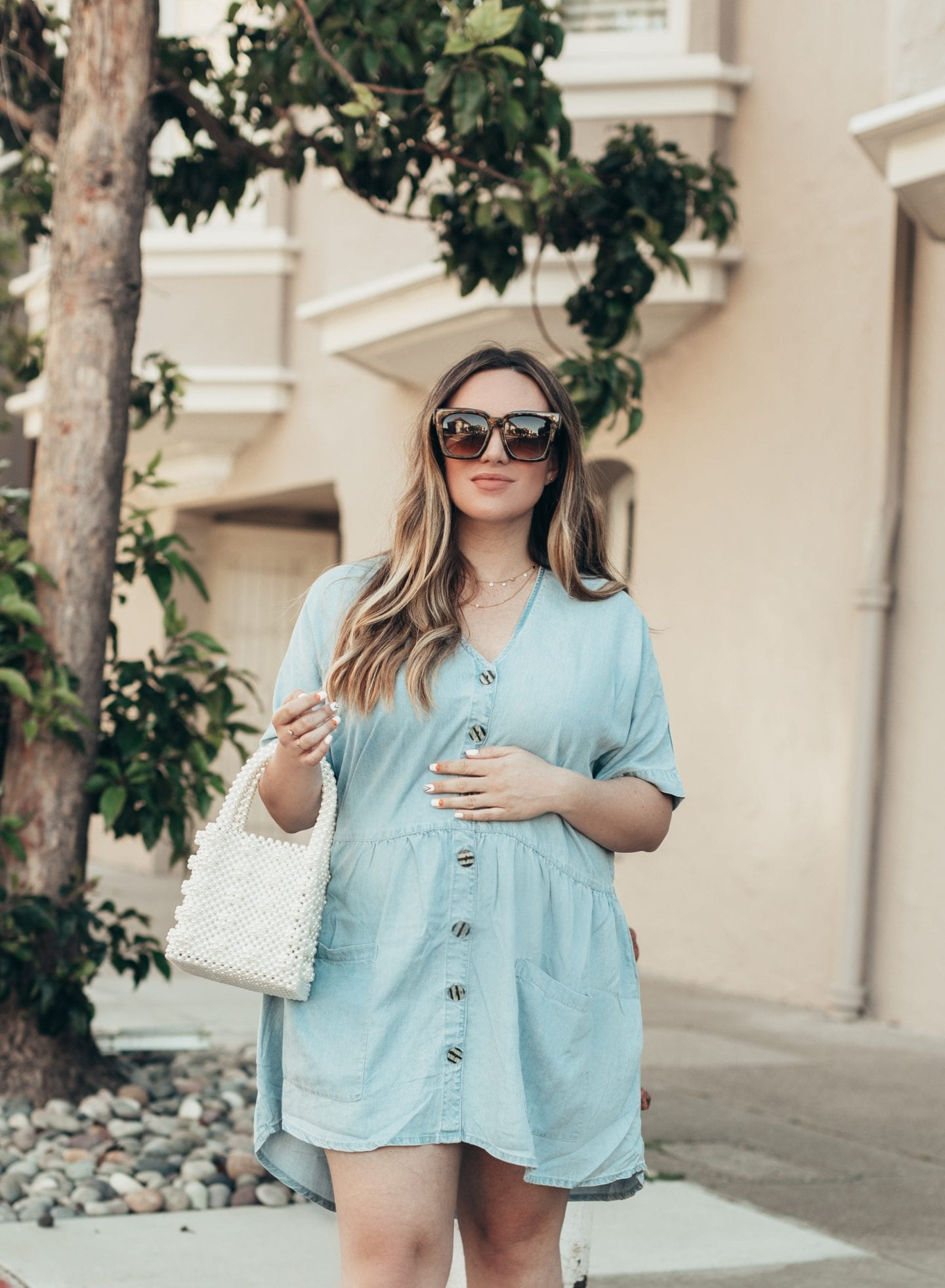 Maternity Style for Each Trimester by popular California fashion blog, Just Add Glam: image of a woman wearing a denim shirt dress.