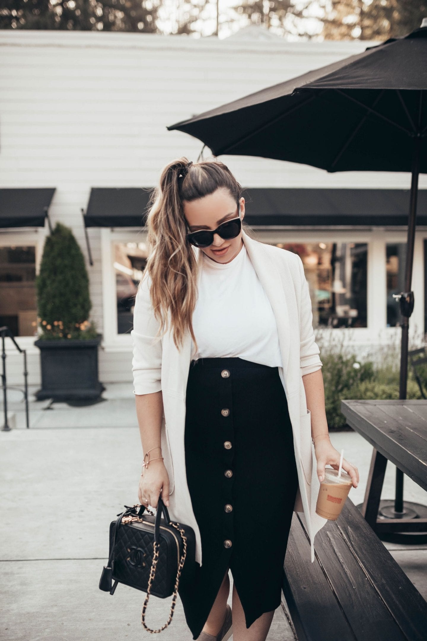 Maternity Style for Each Trimester by popular California fashion blog, Just Add Glam: image of a woman wearing a Asos Mamalicious maternity jersey button through midi skirt.
