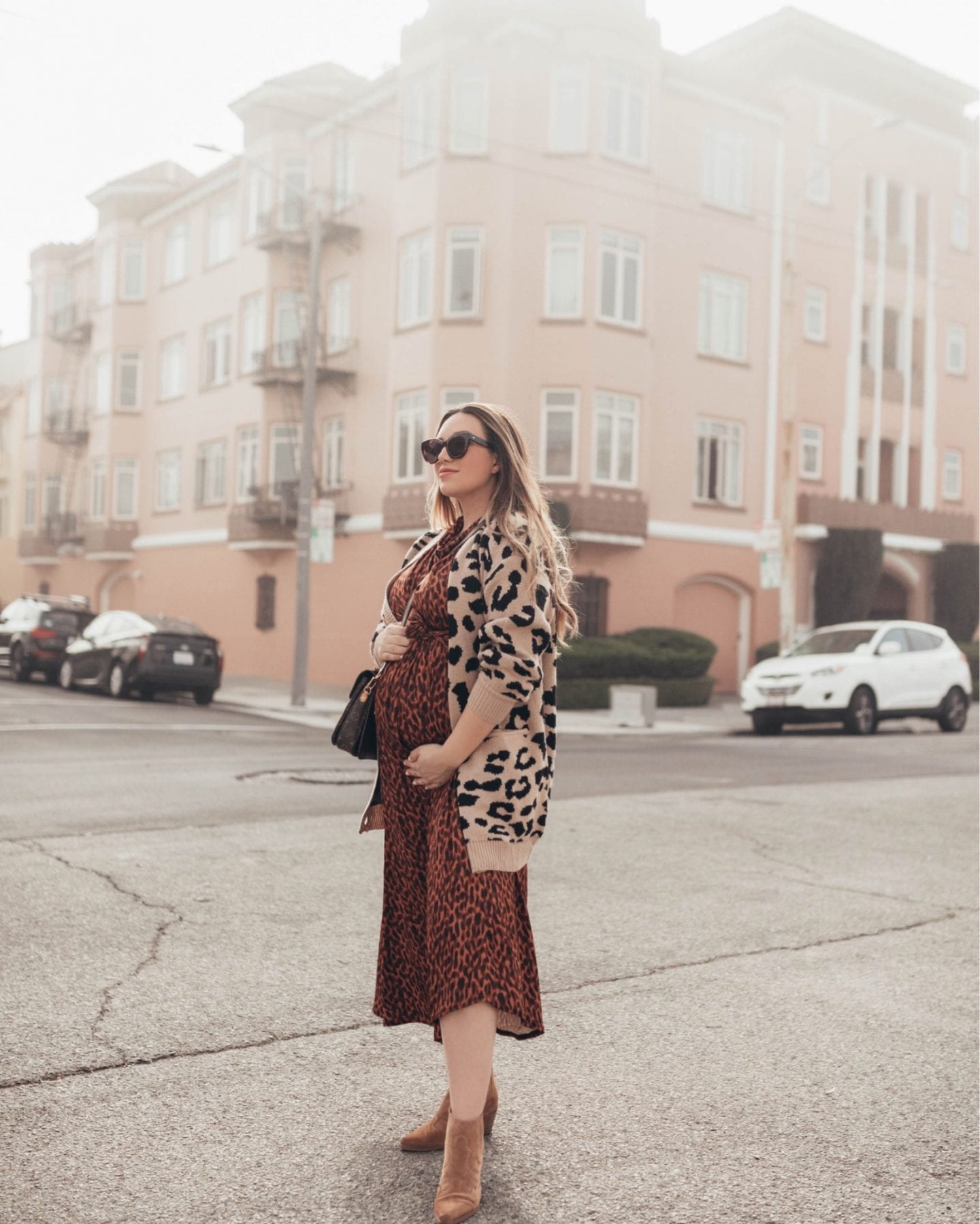 3rd trimester style | Maternity Style for Each Trimester by popular California fashion blog, Just Add Glam: image of a woman wearing a Amazon Angashion Women's Long Sleeves Leopard Print Knitting Cardigan and ASOS Maternity cowl neck tie waist midi dress in tortoiseshell print.