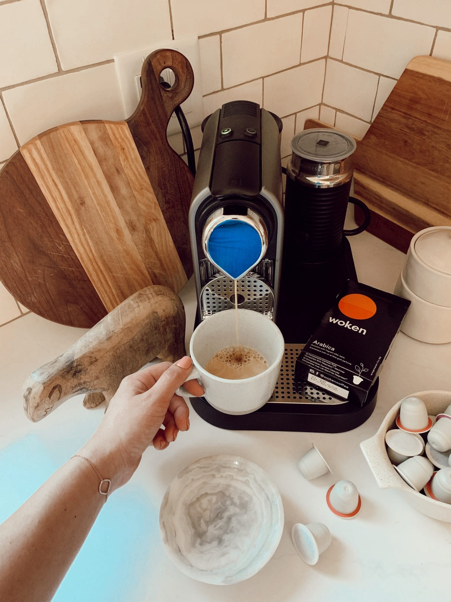 ditching starbucks habit | WHY I'M DITCHING MY STARBUCKS ADDICTION AND HOW YOU CAN TOO by popular San Francisco life and style blog, Just Add Glam: image of a woman using an at home espresso machine.