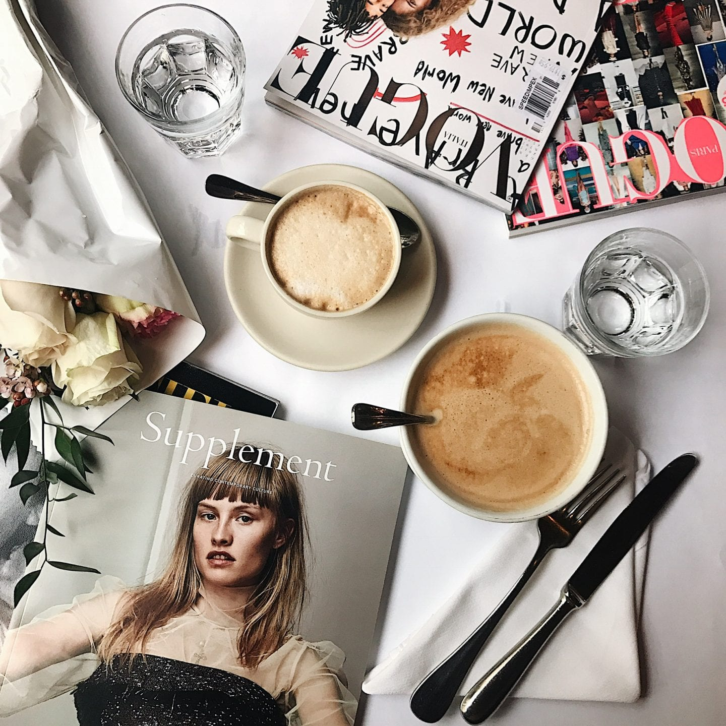 ditching starbucks habit | WHY I'M DITCHING MY STARBUCKS ADDICTION AND HOW YOU CAN TOO by popular San Francisco life and style blog, Just Add Glam: image of a table with magazines, flatware, and coffee cups on it.