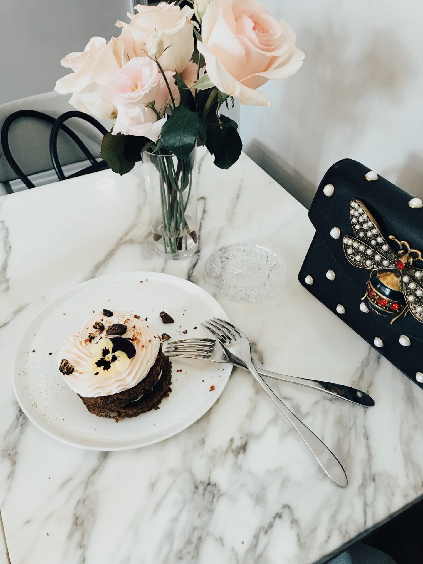 Best Valentine's Day Gifts for Her by popular San Francisco life and style blog, Just Add Glam: image of a small cake and a vase of light pink roses.