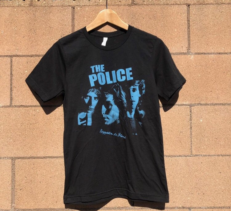 Police Band Tee Just Add Glam | 30 BEST VINTAGE BAND TEES by popular San Francisco life and style blog, Just Add Glam: image of a vintage The Police tee.