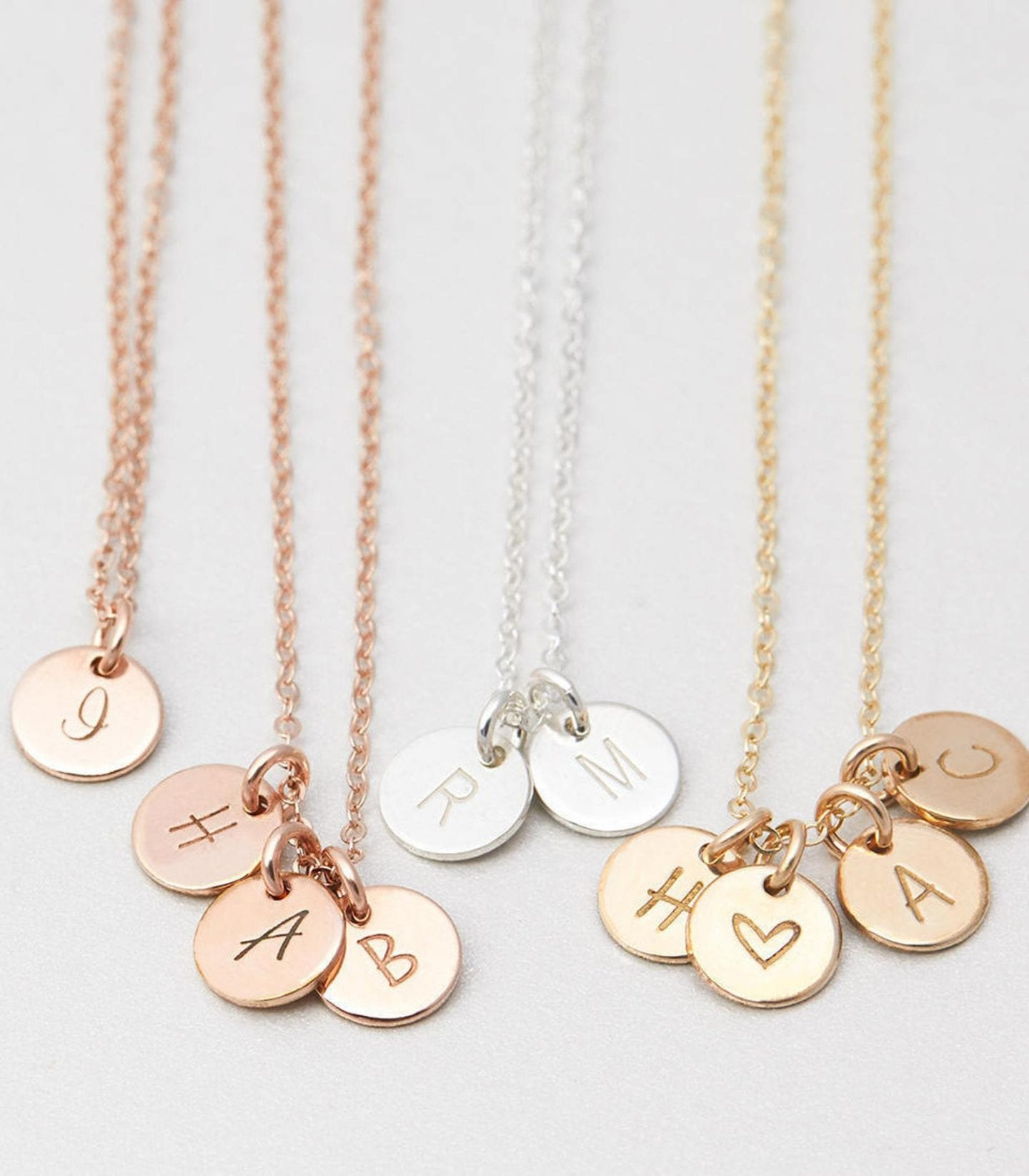 Initial Jewelry by popular San Francisco fashion blog, Just Add Glam: image of a tiny disc necklace.