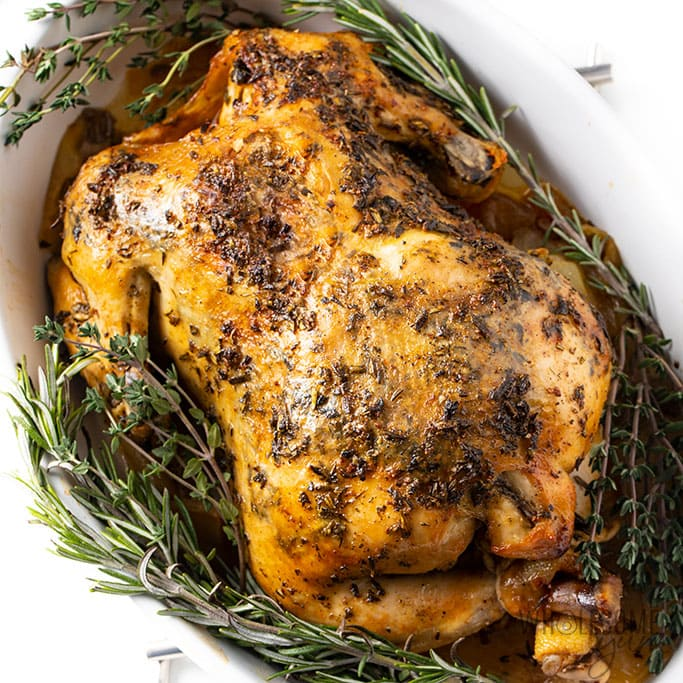 wholesomeyum-crock-pot-whole-chicken-recipe-just-add-glam | HEALTHY KETO CROCKPOT RECIPES TO EASE YOU INTO THE NEW YEAR by popular San Francisco life and style blog, Just Add Glam: image of Crockpot whole chicken recipe with herb butter.