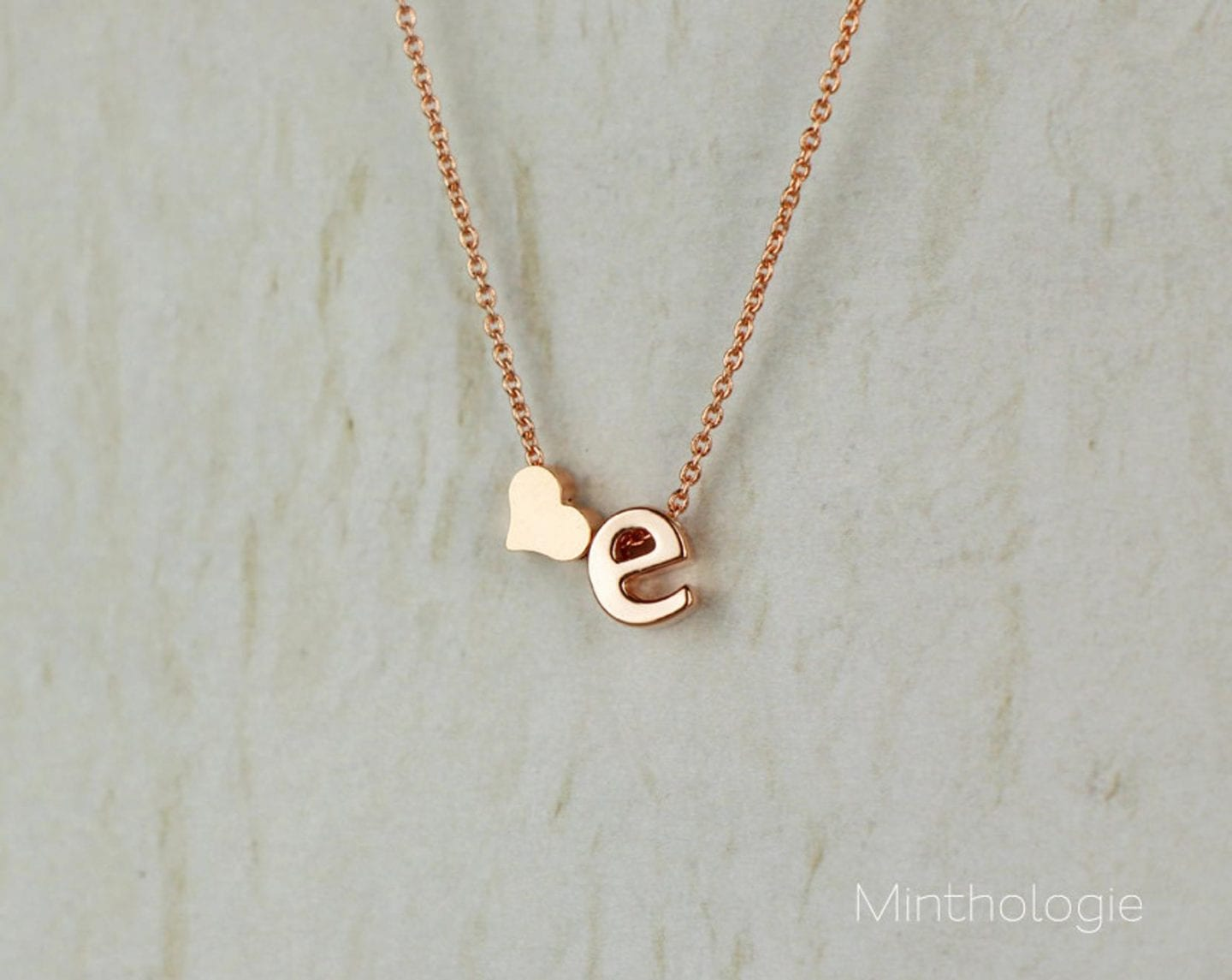 Initial Jewelry by popular San Francisco fashion blog, Just Add Glam: image of a ono heart initial necklace.
