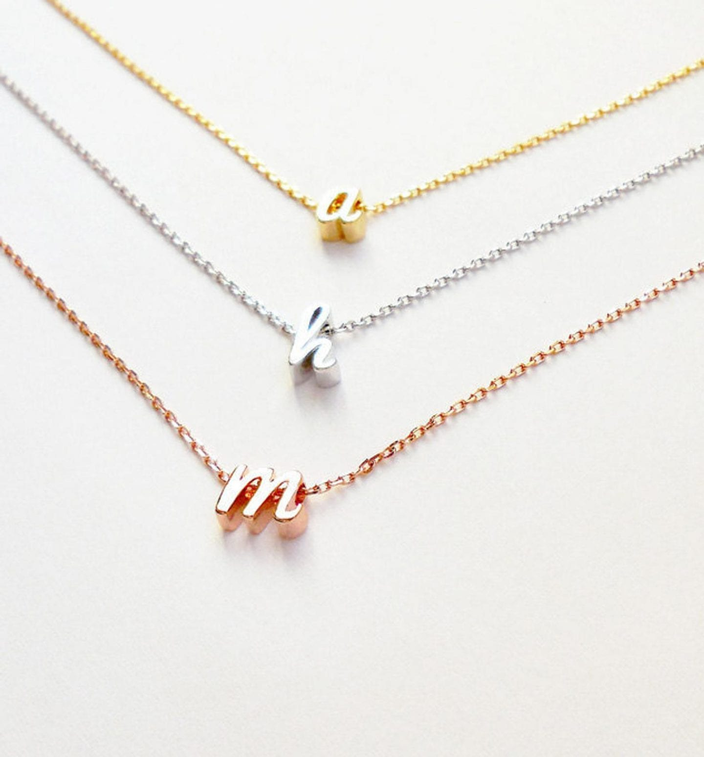 Initial Jewelry by popular San Francisco fashion blog, Just Add Glam: image of a tiny initial letter necklace.