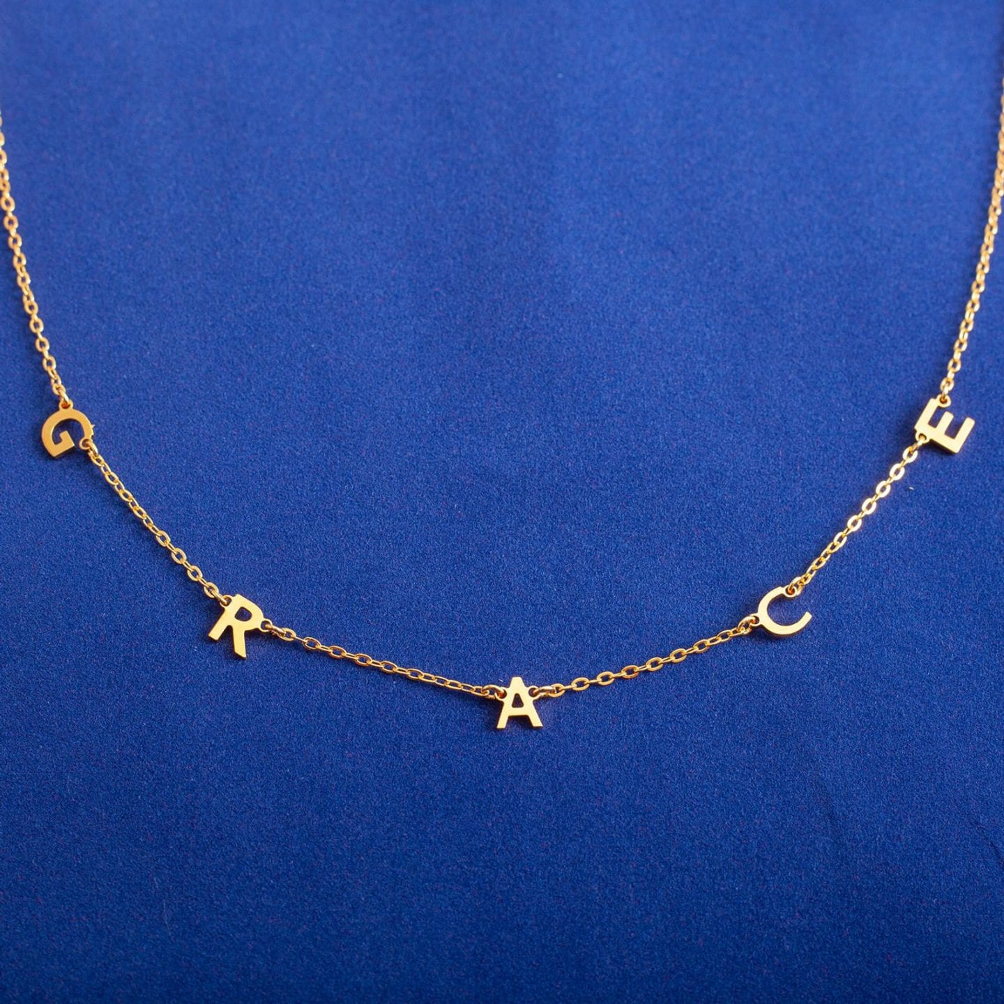 Initial Jewelry by popular San Francisco fashion blog, Just Add Glam: image of a initial necklace.
