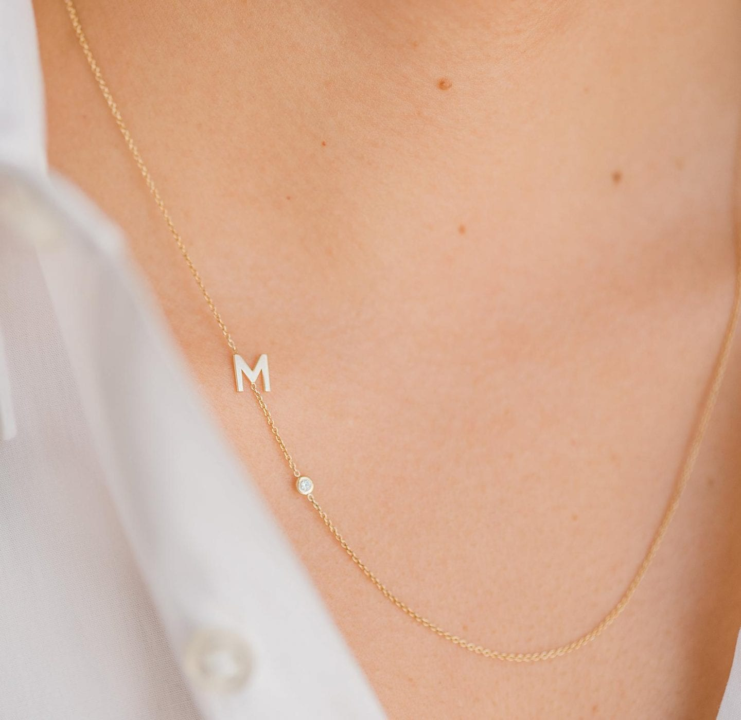 Initial Jewelry by popular San Francisco fashion blog, Just Add Glam: image of a 14k gold letter necklace with small diamond.