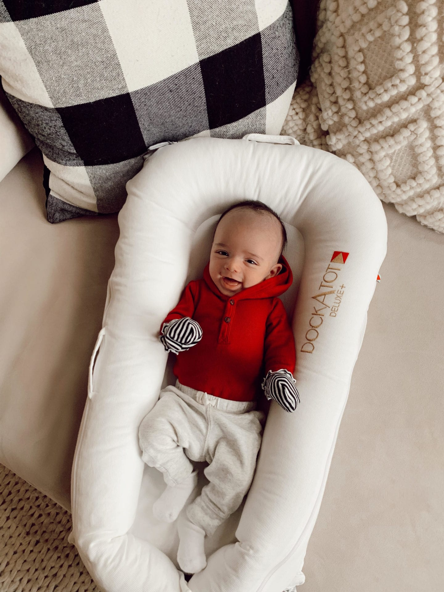 DockATot review by popular San Francisco motherhood blog, Just Add Glam: image of a baby boy laying in a DockATot.