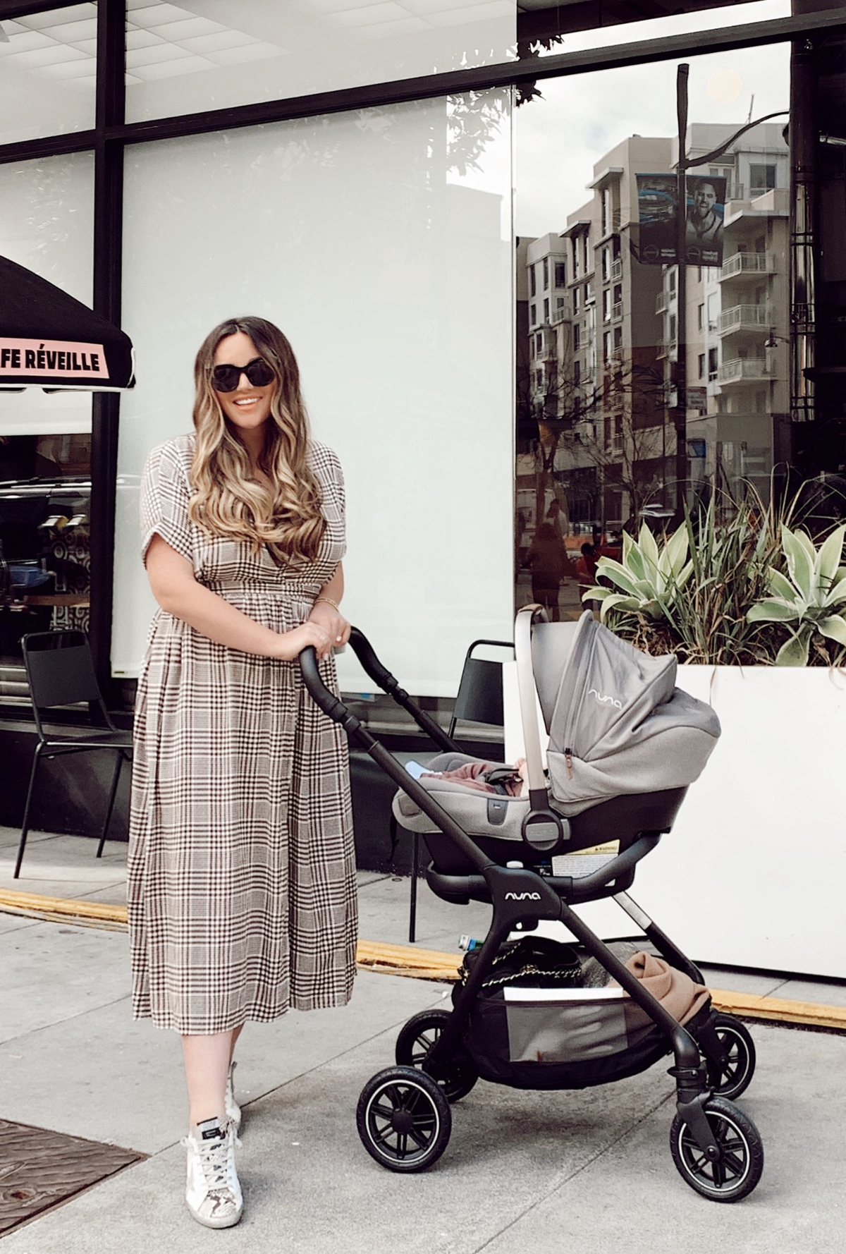 Nordstrom Anniversary Sale by popular San Francisco motherhood blog: image of a mom pushing her baby in a Nuna Mixx stroller.