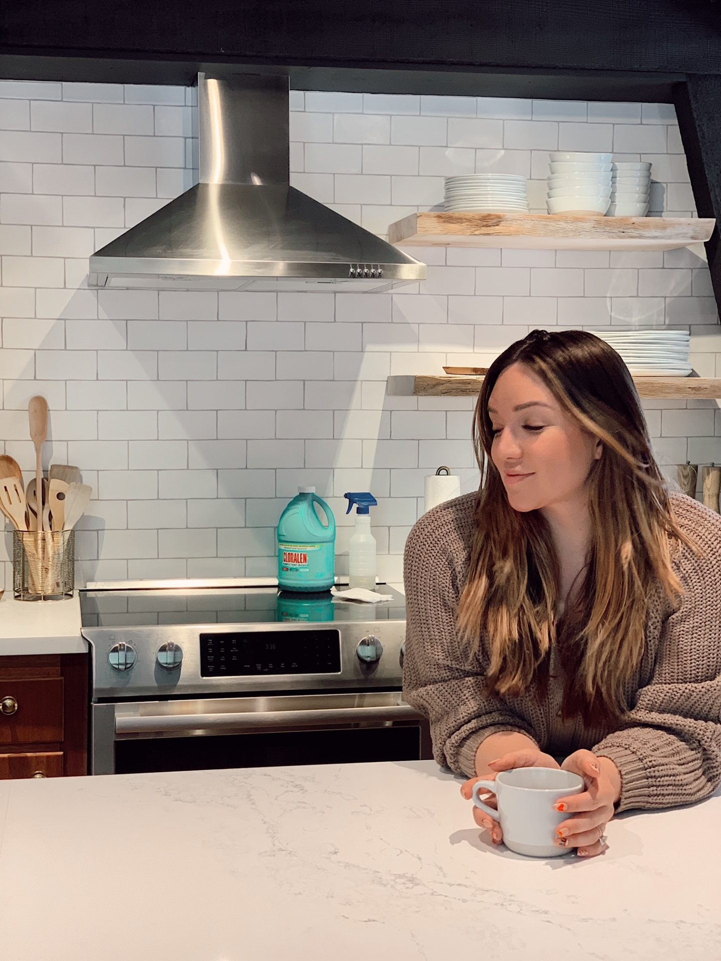Cleaning with CLORALEN |Spring Cleaning Tips by popular San Francisco lifestyle blog, Just Add Glam: image of woman holding a ceramic mug and leaning on her kitchen counter.