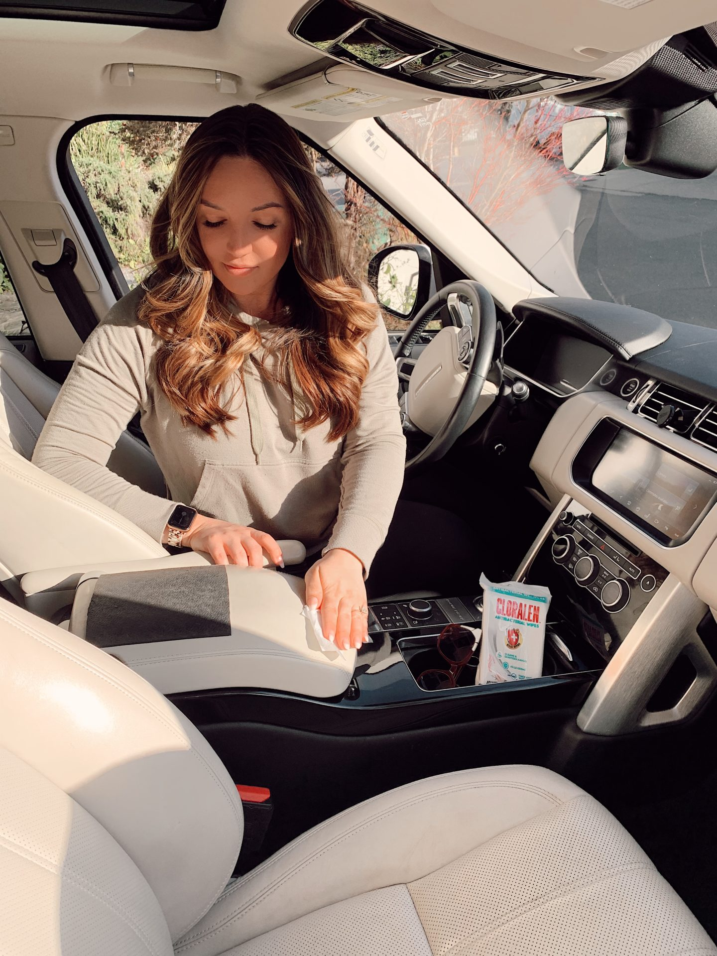 Spring Cleaning Hacks by popular San Francisco lifestyle blog, Just Add Glam: image of a woman using Cloralen wipes in her car.