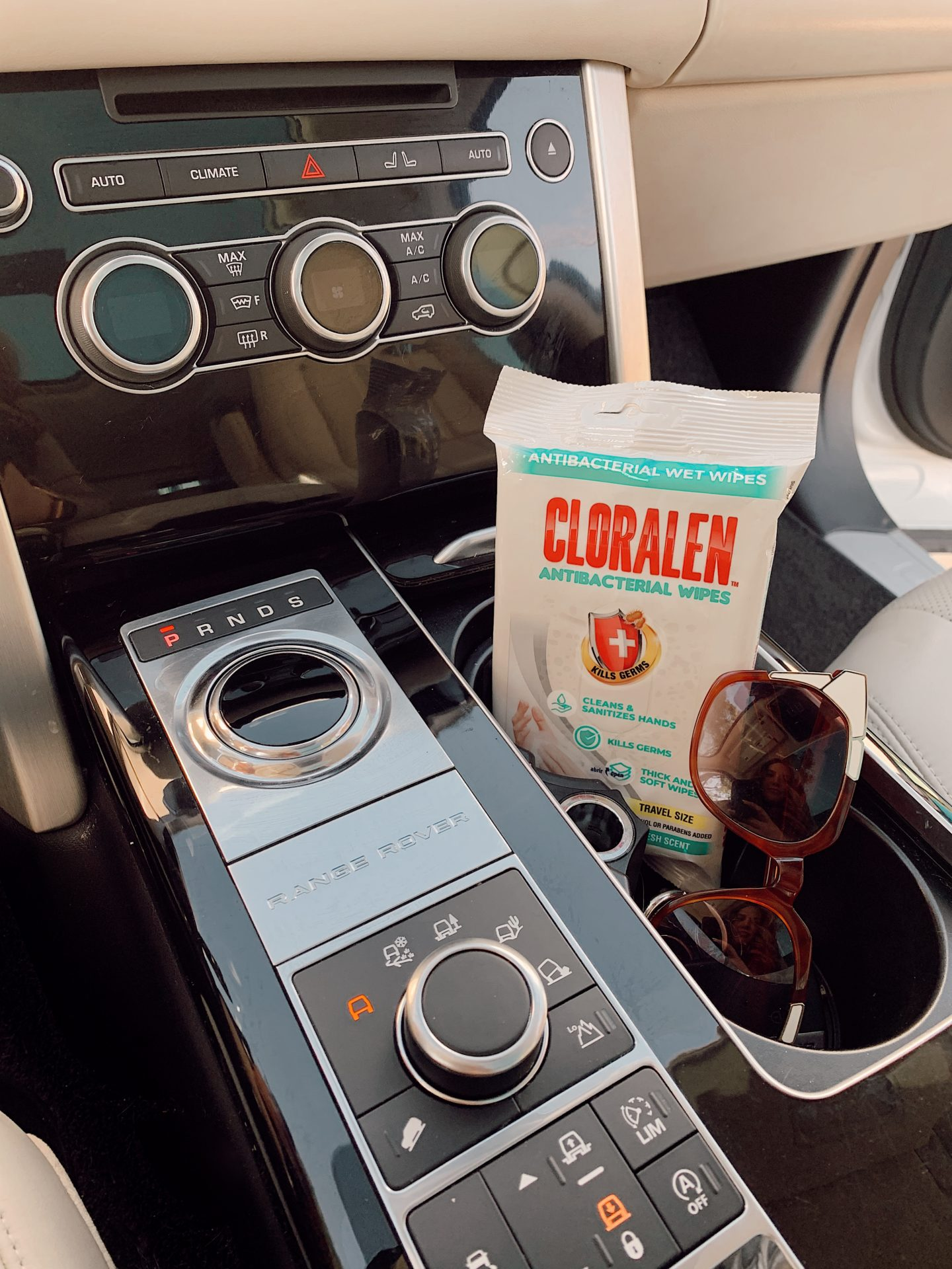 CLORALEN wipes |Spring Cleaning Hacks by popular San Francisco lifestyle blog, Just Add Glam: image of Cloralen wipes in a car next to some sunglasses.